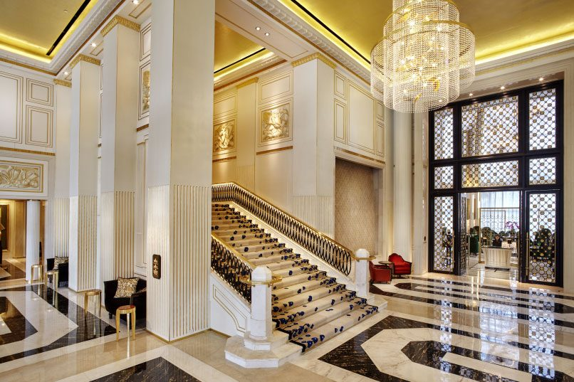 Guests will be greeted by a soaring lobby with a grand staircase upon entry.