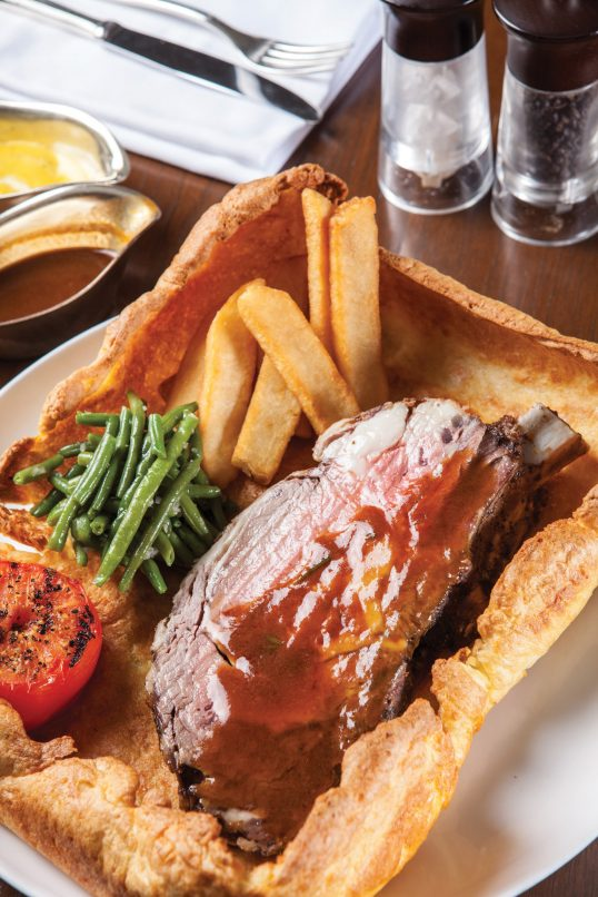 The Australian Black Angus Prime Rib at Arthur's Bar & Grill is a must-try for meat lovers.
