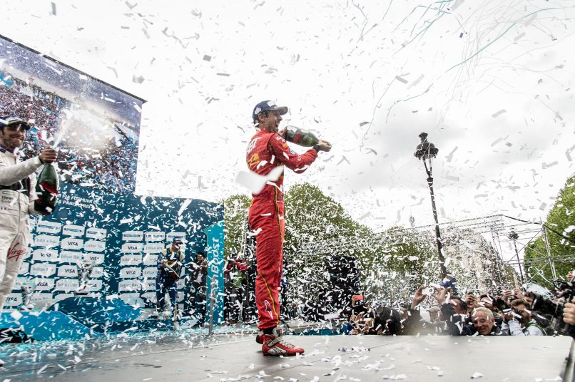 Lucas Di Grassi celebrating his victory with Mumm Grand Cordon