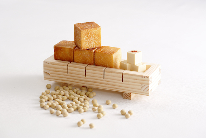 The Brioche Is Light And Buttery Served With Symmetrical Cubes Of Tofu Butter