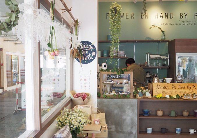 flower in hand coffee shop