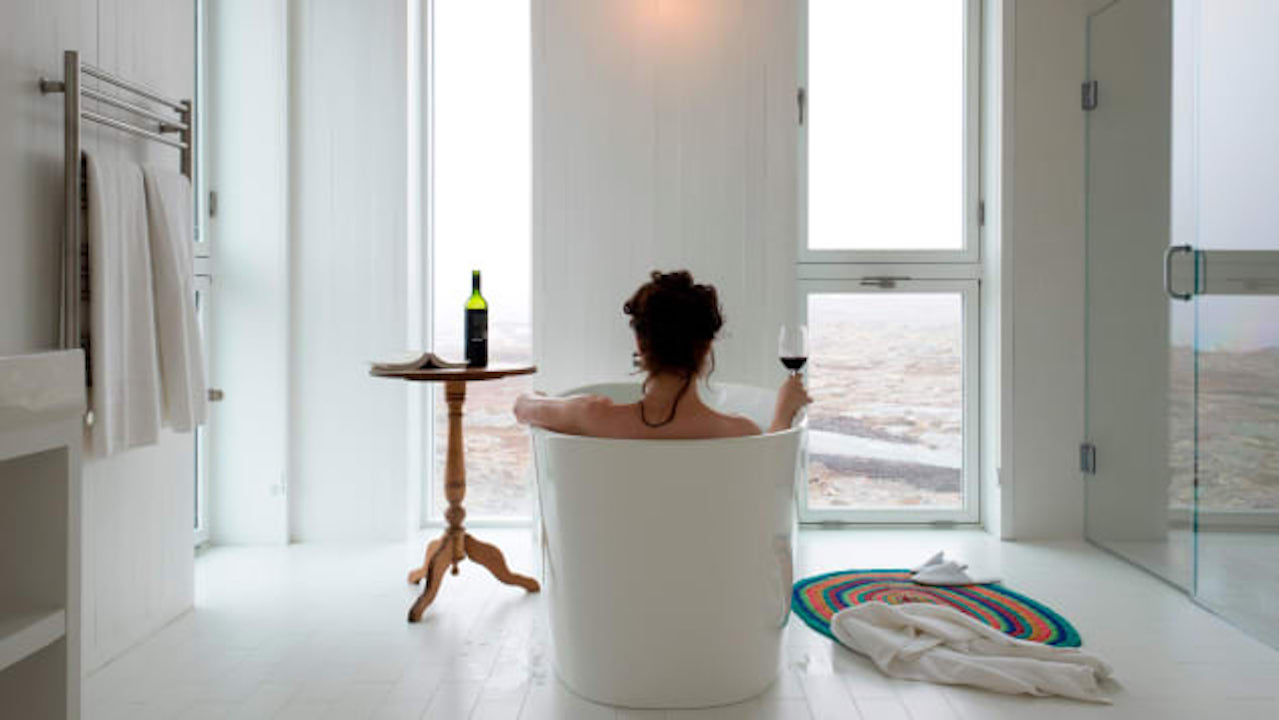View of artic icebergs from the bathtub at Fogo Island Inn, Newfoundland, Canada