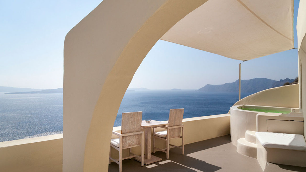 Bathtub overlooking the Aegean Sea at Mystique hotel, Santorini, Greece
