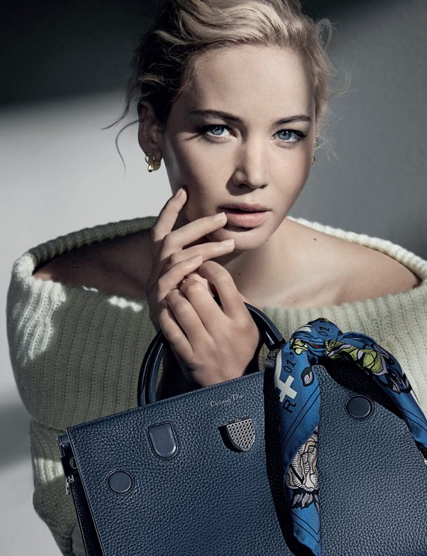 Jennifer Lawrence smoulders in the campaign visuals holding a medium Diorever bag in meteorite grey taurillon, complete with a scarf for added accessory.