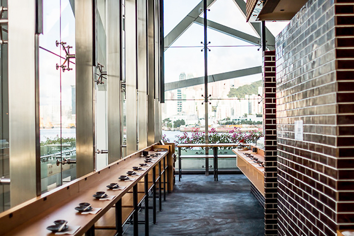 The stand-up sushi section with a beautiful view of the Victoria Harbour. (photo credit: supertastermel.com)