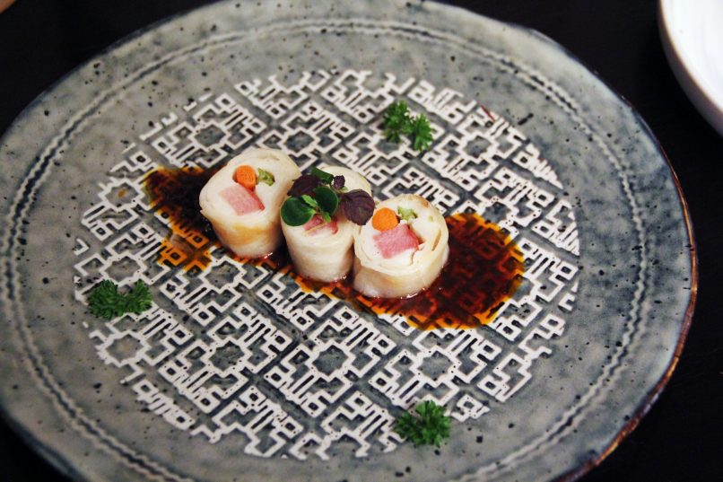 Steamed smoked duck -mo mo- skin rolls with red oil sauce
