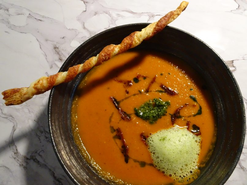 The roasted tomato soup gets a gourmet twist with basil foam, a Parmesan Grissini and more pesto genovese.