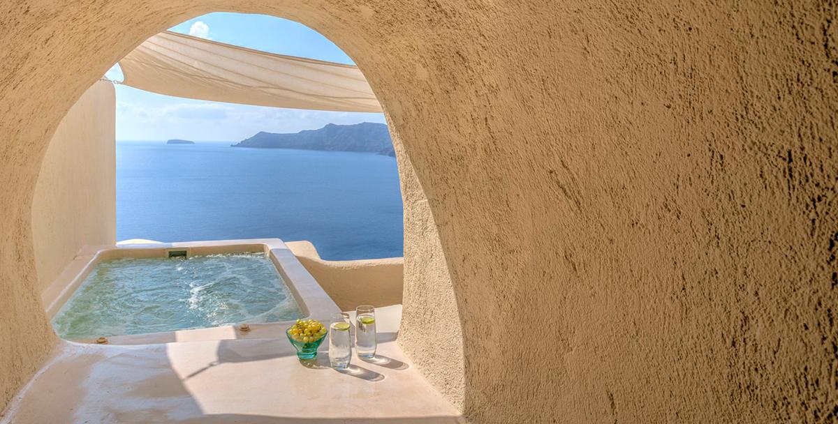 Bathtub overlooking the Aegean Sea at Mystique hotel, Santorini