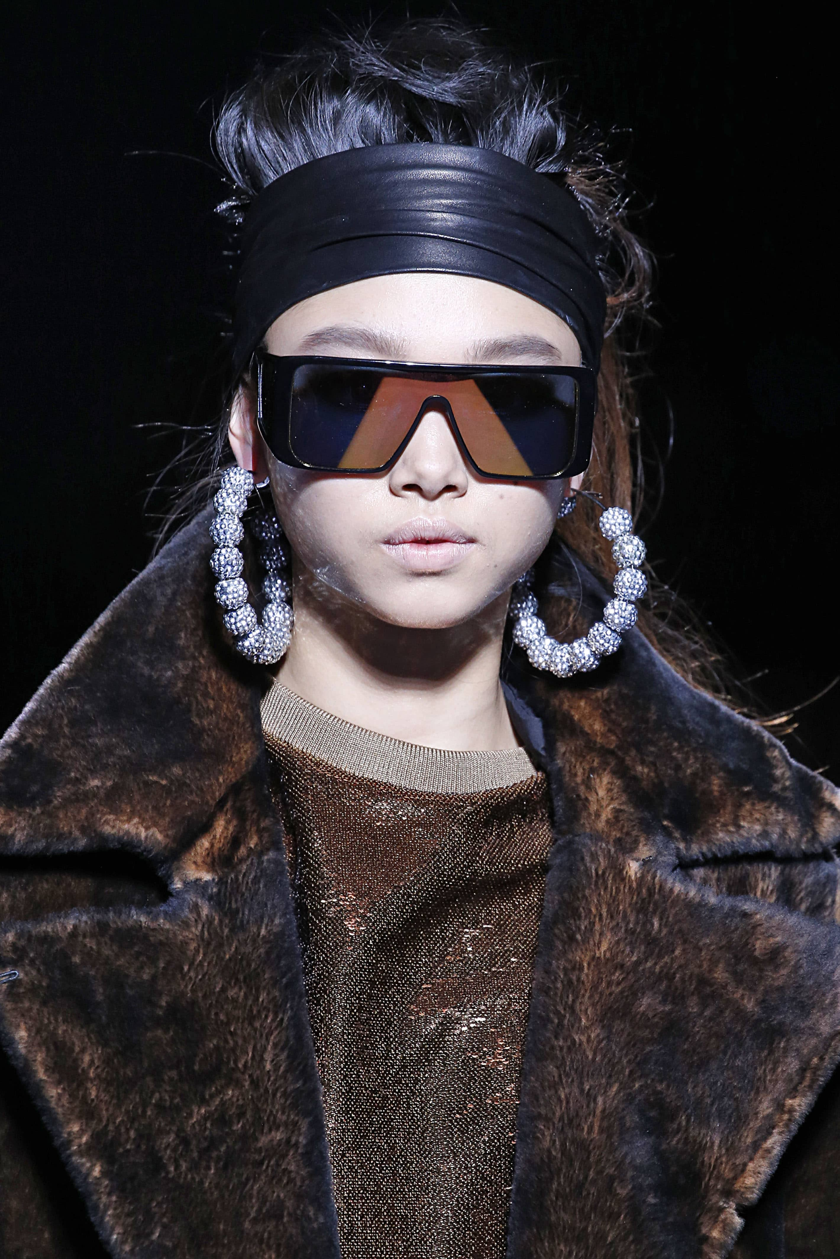 Tom Ford's 80's inspired hoops. Image: Courtesy Victor VIRGILE/Gamma-Rapho via Getty Images