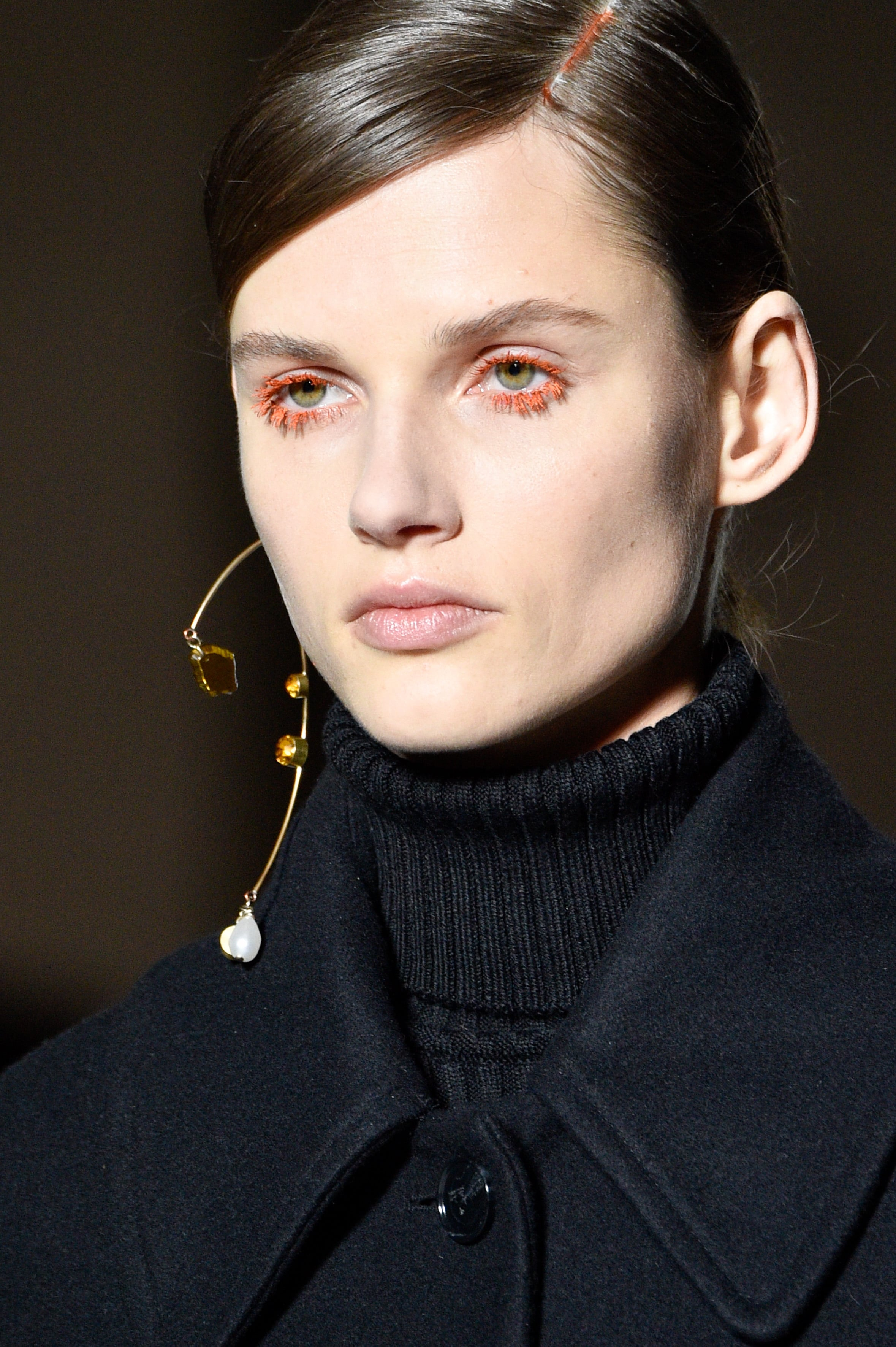 Dries Van Noten's architectural single earring. Image: Courtesy Peter White/Getty Images