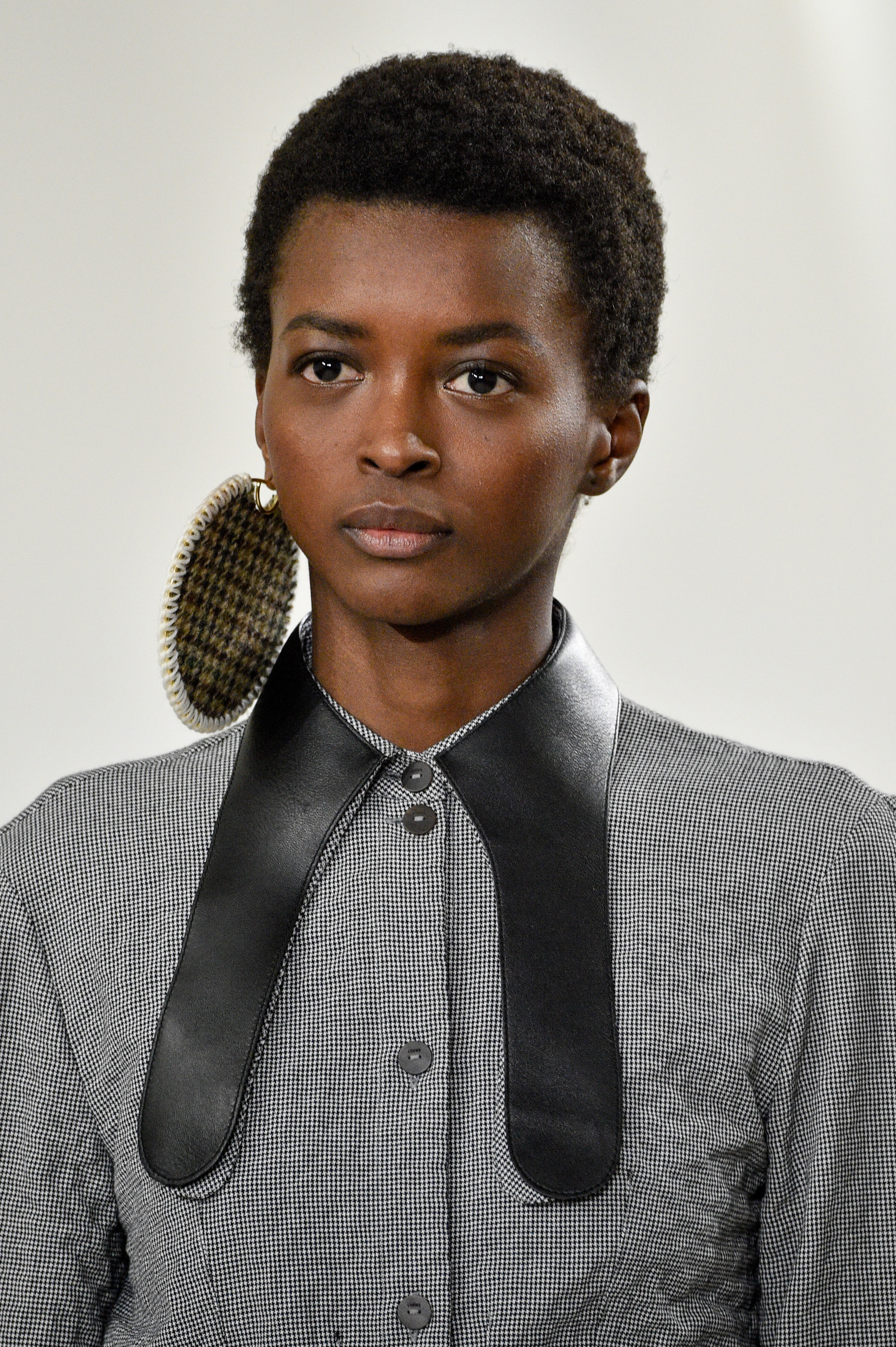 Amira Pinheiro carrying a massive disc earring for Loewe. Image: Courtesy Peter White/Getty Images