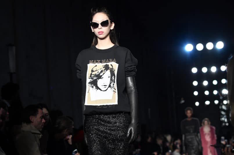 A model carrying a Max Mara logo-d sweat at Fall/Winter 2018-19. Image: Courtesy Jacopo Raule/Getty Images