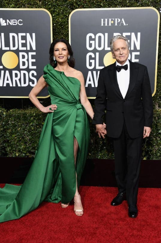 BEVERLY HILLS, CA - JANUARY 06: 76th ANNUAL GOLDEN GLOBE AWARDS -- Pictured: (l-r) Catherine Zeta-Jones and Michael Douglas arrive to the 76th Annual Golden Globe Awards held at the Beverly Hilton Hotel on January 6, 2019. -- (Photo by Kevork Djansezian/NBC/NBCU Photo Bank)