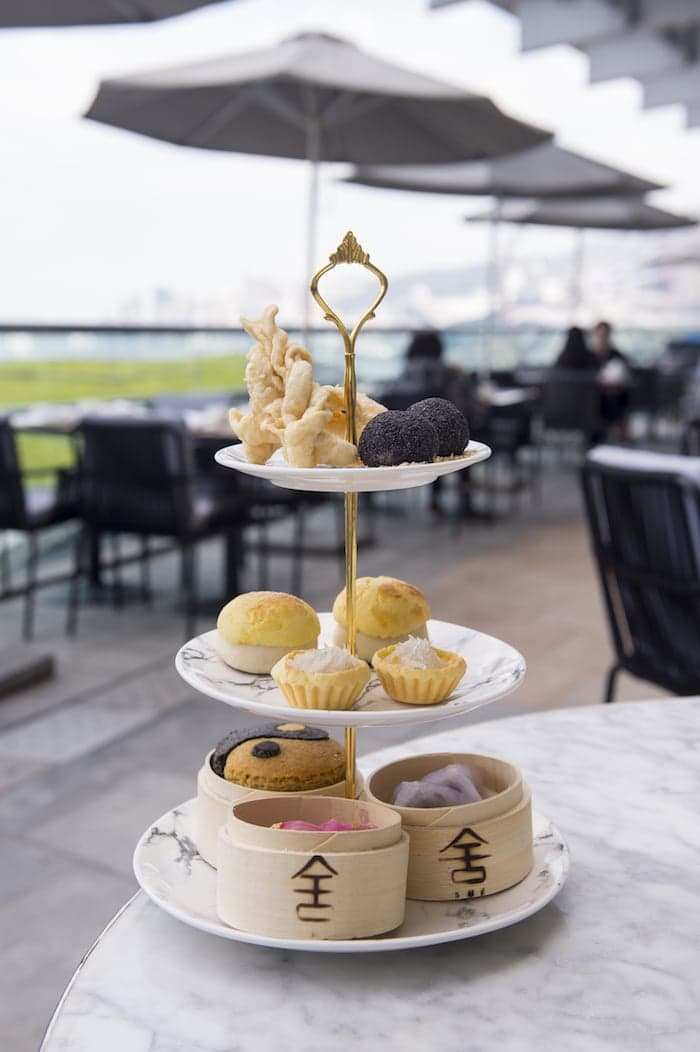 Afternoon tea offers bite-sized specialties such as truffle balls and beetroot-tinted har gao.