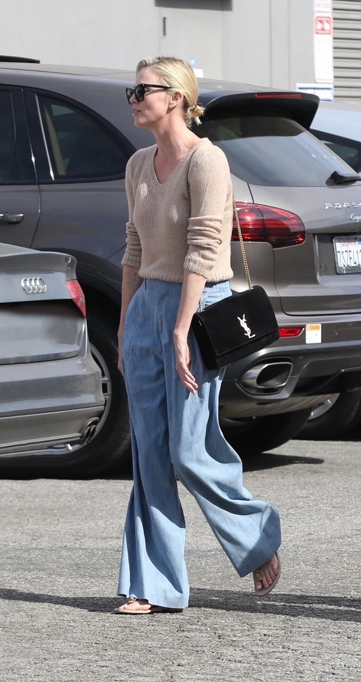 Charlize Theron is seen wearing the Reversible Kate.