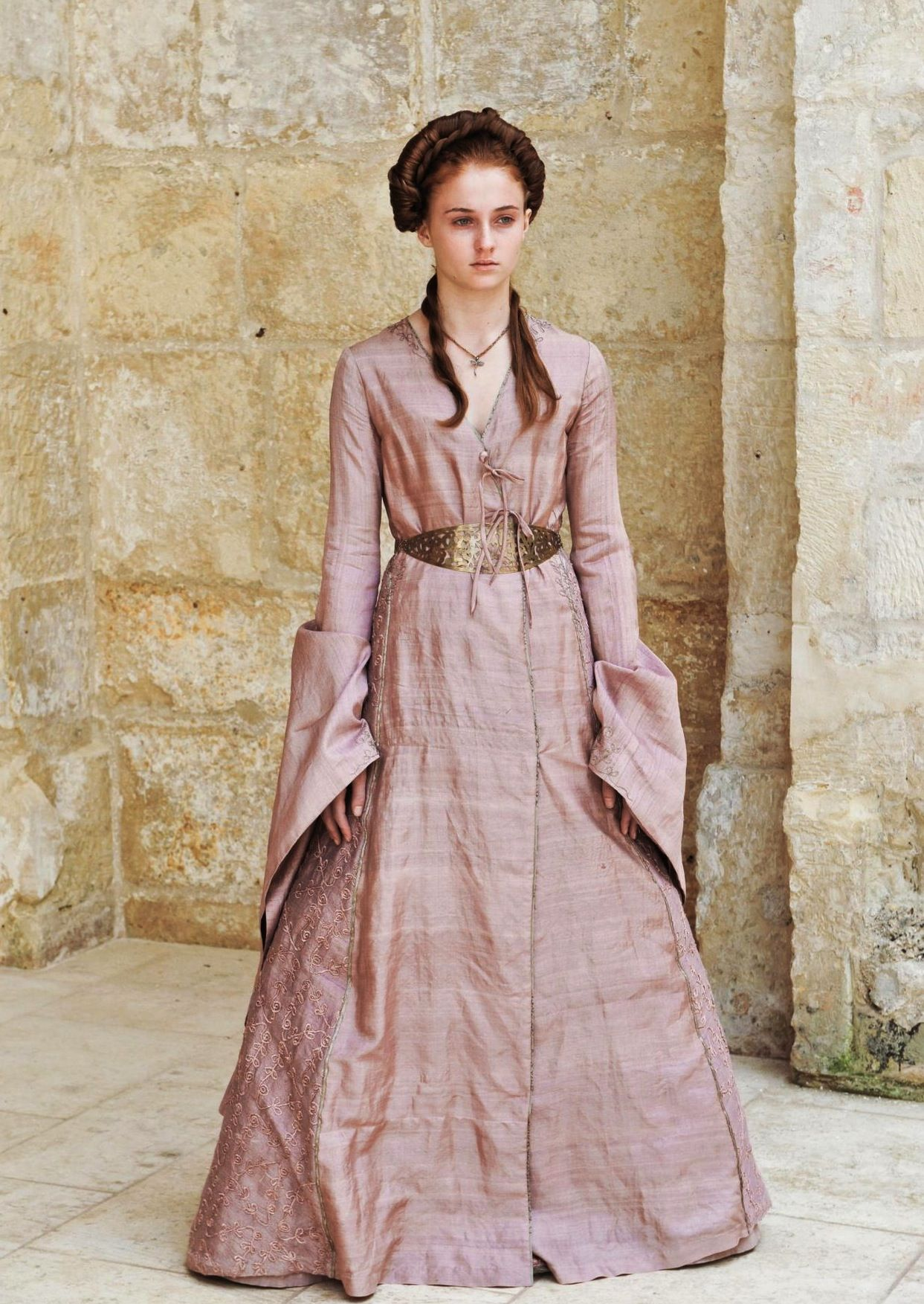 Game of Thrones, Sansa Stark wearing a soft pink dress in the first season.