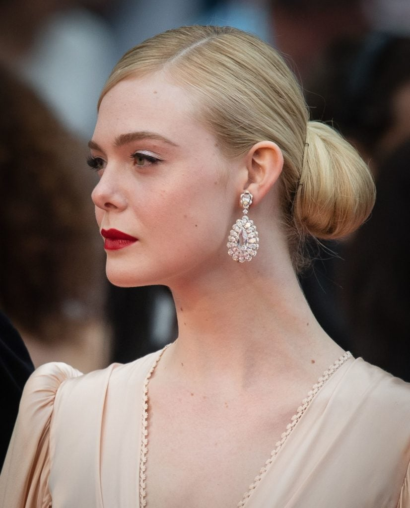 Elle Fanning in Chopard earrings. Image Courtesy Getty