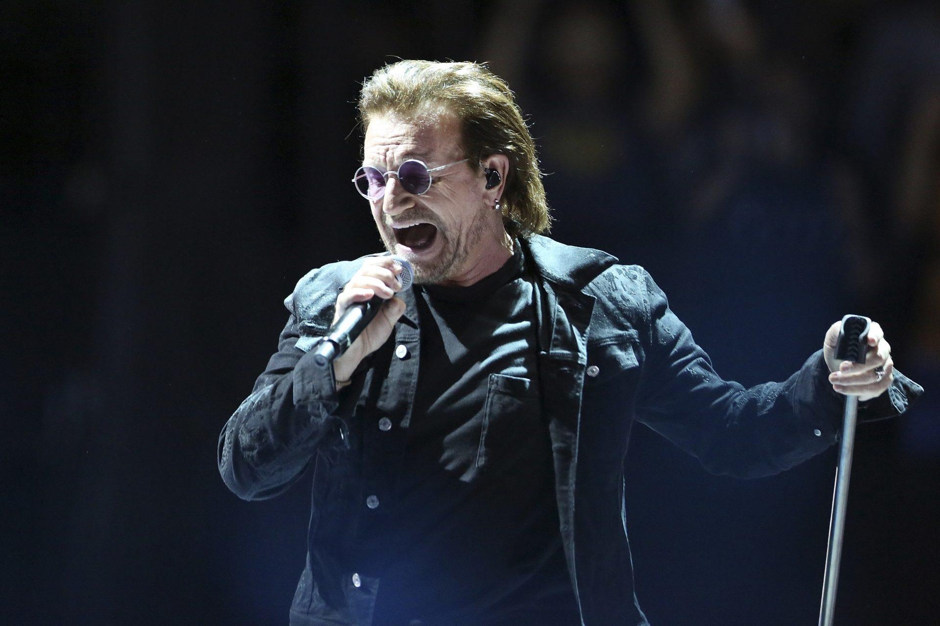 U2 lead singer Bono performs in Paris