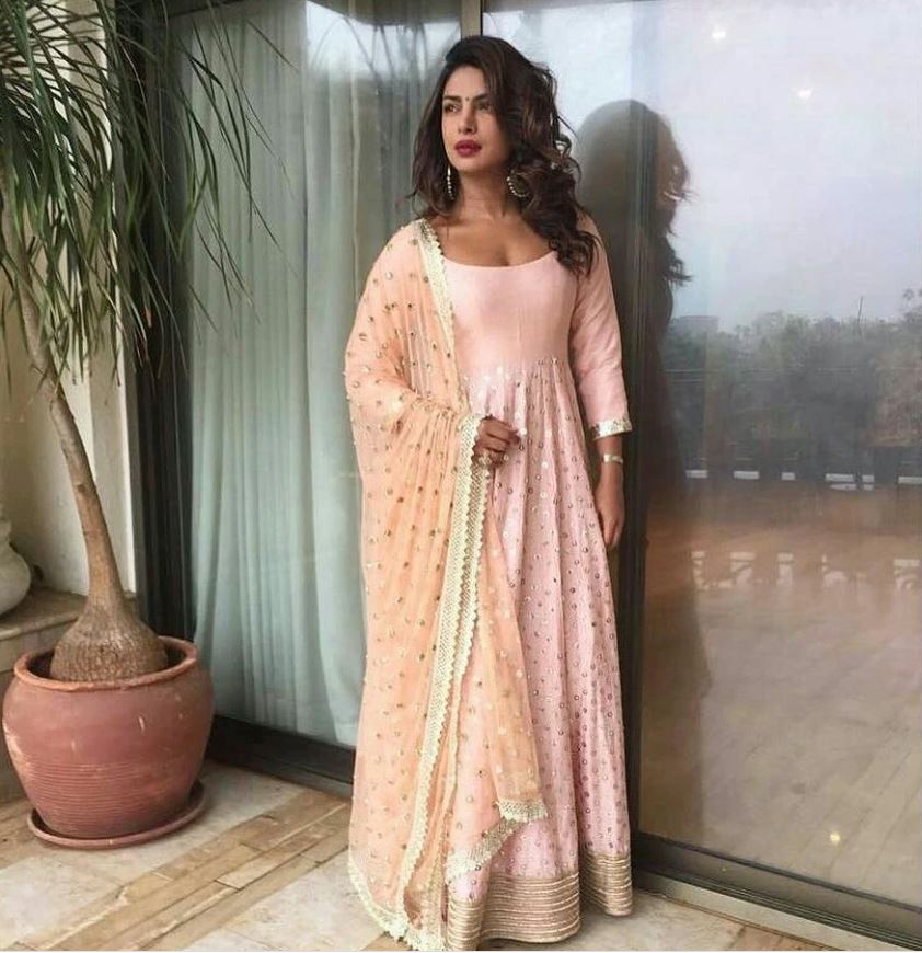 Keeping it ethnic at a cocktail is never a bad idea. This floor-length peach anarkali adorned by Priyanka Chopra fits the occasion. Image: Courtesy Pinterest