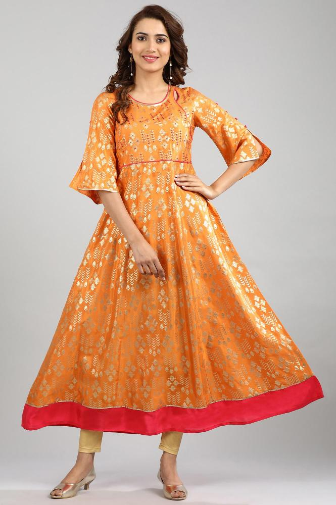 A flared, double-duty kurta can your hero piece for a reception. Pair with churidars, denims even pre-draped dhotis.