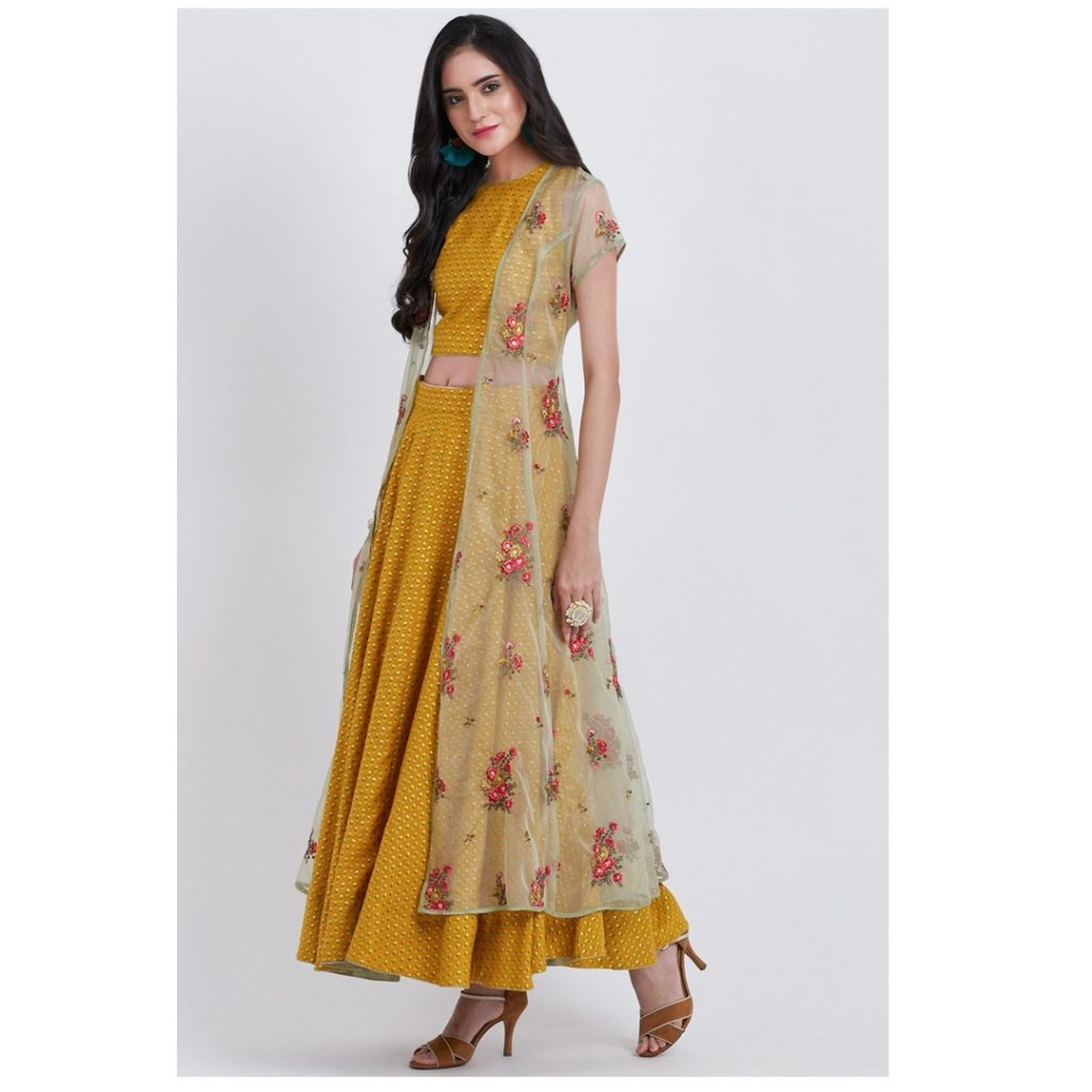 Yellow is a perfect hue for an engagement. Go for breathable fabrics and a look sans dupatta for the much needed comfort through all that dancing. Pack a dramatic punch with this yellow three piece dress from Biba India made with Liva fabric.