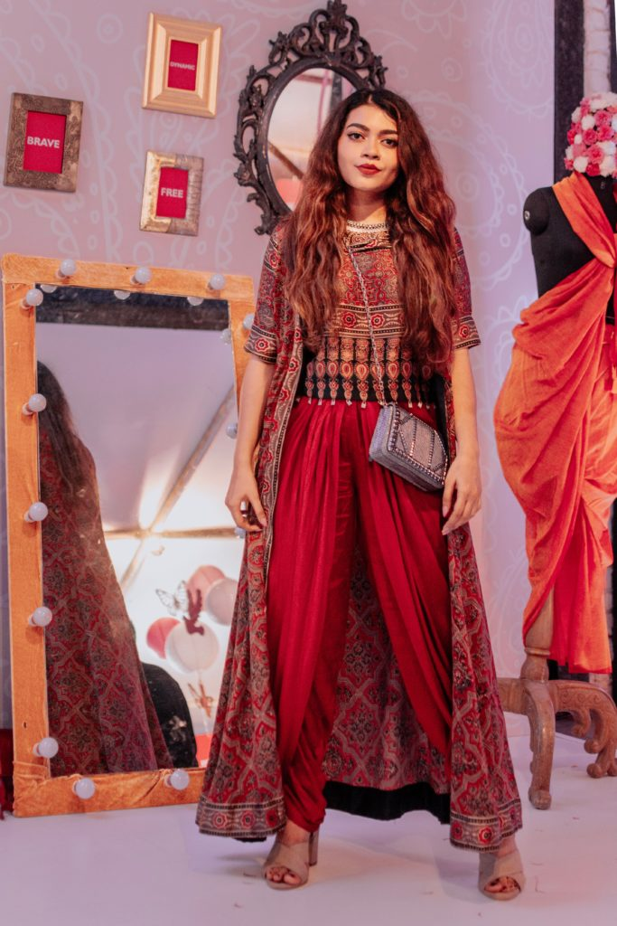 Influencer Gia Kashyap impresses us with how a lightweight robe, casually thrown over a pair of dhoti trousers makes for a winning fusion look. Just in case want to accentuate your shape, pair a statement belt and you are sorted. Get this comfortable and stylish piece made with Liva from Biba India.
